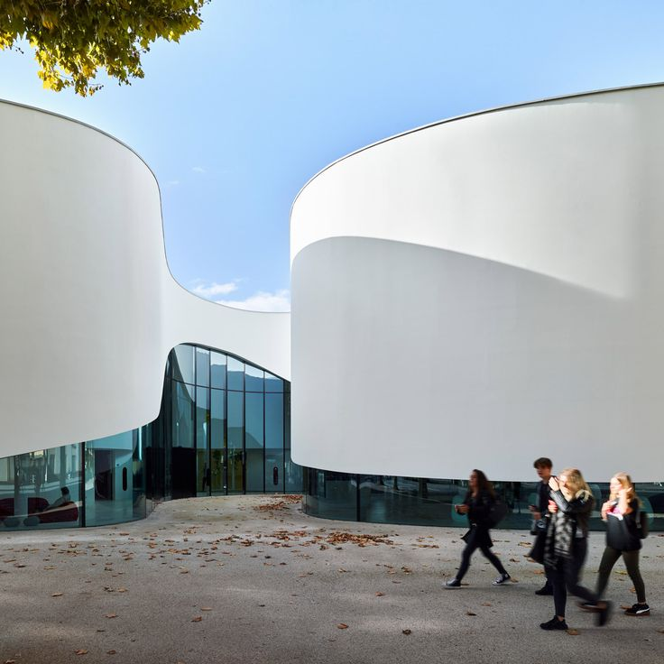 Dominique Coulon & Associés has completed a media library in Thionville, France, featuring a wavy facade that lifts up to reveal ribbons of glazing.