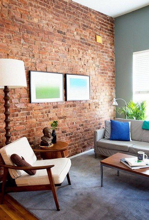 Декор гостиной комнаты с кирпичной стеной