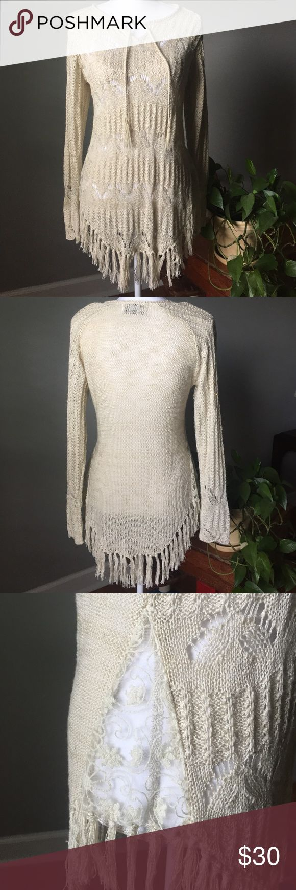 "Crochet Top Really cute cream colored crochet long sleeve top. Has draw strings at top to toe. Has slit on sides with a sheer material sewed into slits. Fringe on bottom. Never worn so no stains or tears or snags. No fringe is missing . 17"" bust. 29"" in length. There is some stretch to top. There is not a size tag in top but I would say it's a medium Tops Blouses"