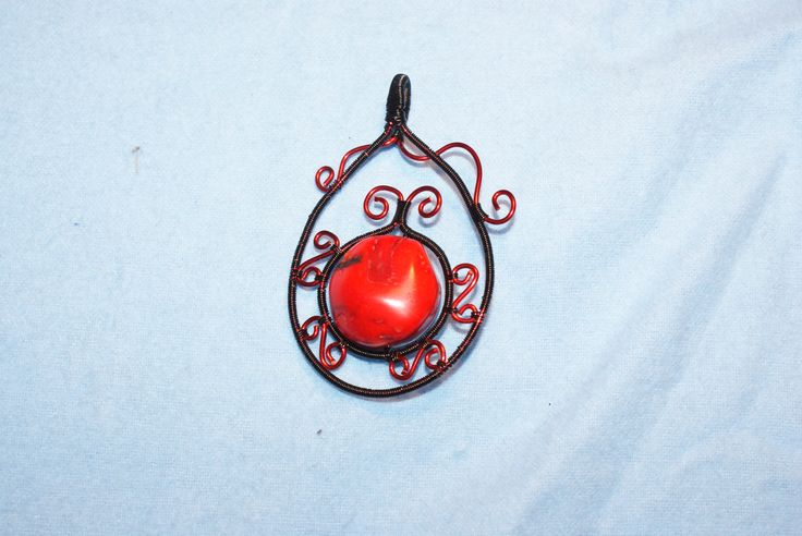 Wire wrapped, red coral bead.