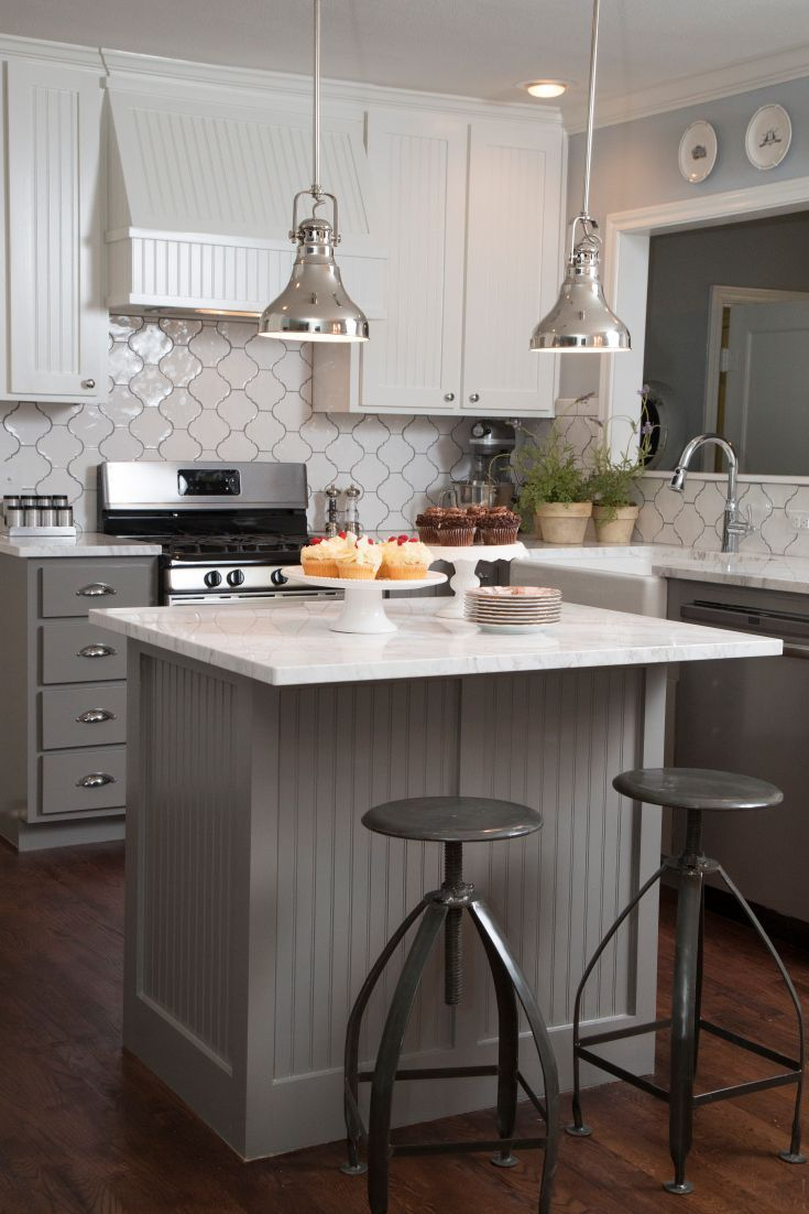 Fixer upper kitchen table decor - Fixer Upper White And Grey Kitchen Features White Beadboard Upper Cabinets And Gray Beadboard Lower Cabinets Paired With White Quartz Countertops And