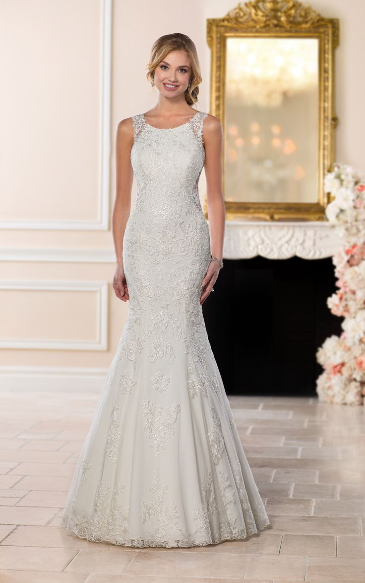 Cute Stella York wedding gown at The Bridal Cottage highneck lace train