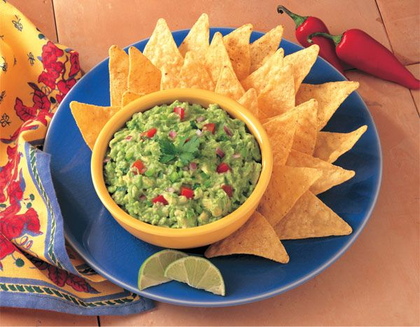 Guacamole:  is an avocado-based sauce that originated with the Aztecs in Mexico.   It has become part of the United States cuisine as a dip, condiment and salad ingredient. It is traditionally made by mashing ripe avocados with a molcajete (mortar and pestle) with sea salt. Some recipes call for tomato, onion, lime juice, chili, yogurt and/or additional seasonings.