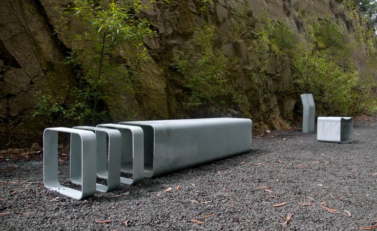 Public bench / original design / steel / with integrated bike rack RUA by J.M.Carvalho Araújo