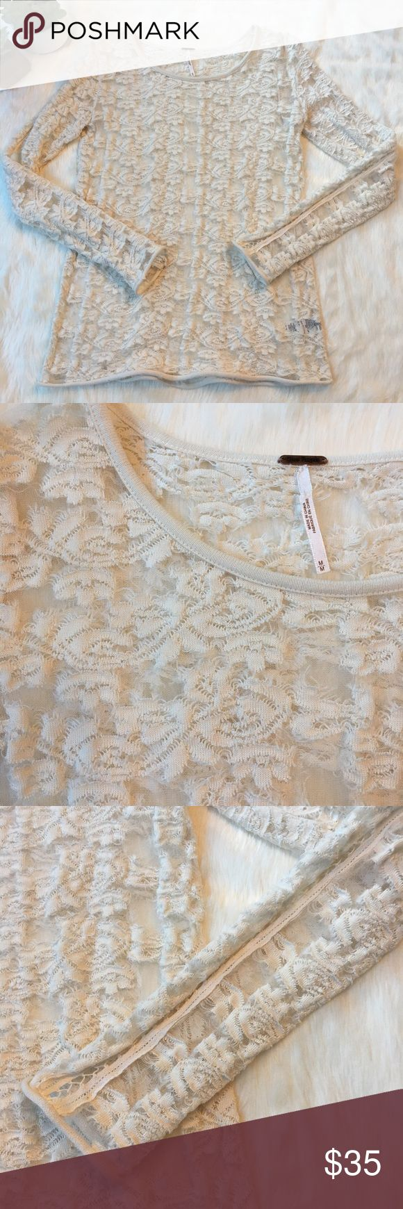 Free People cream lace long sleeve top Gorgeous cream lace top with lots of stretch. Netting down top of sleeve. Free People Tops Blouses