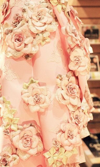"""Fleurs de papiers - Another example of """"less is more"""" - just a portion of the dress is showing but that is all you need to see."""