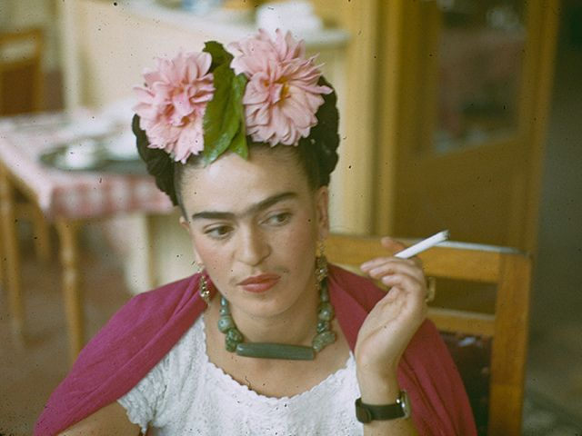 Frida Kahlo, relaxing and smoking a cig.