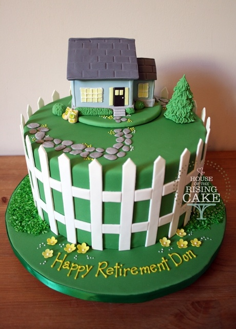 Cute cottage and picket fence cake