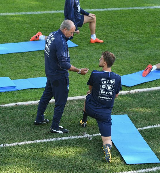 Head coach Italy Gian Piero Ventura (L) and Daniele Rugani chat during a training session at Italy club's training ground at Coverciano on October 2, 2017 in Florence, Italy.