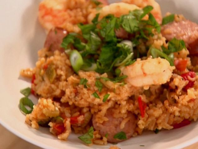 Shrimp and Sausage Jambalaya from FoodNetwork.com  This looks like it will make a lot...I am looking for volunteers to come help me eat this, it will be the first thing I make when I unpack my kitchen!! :)