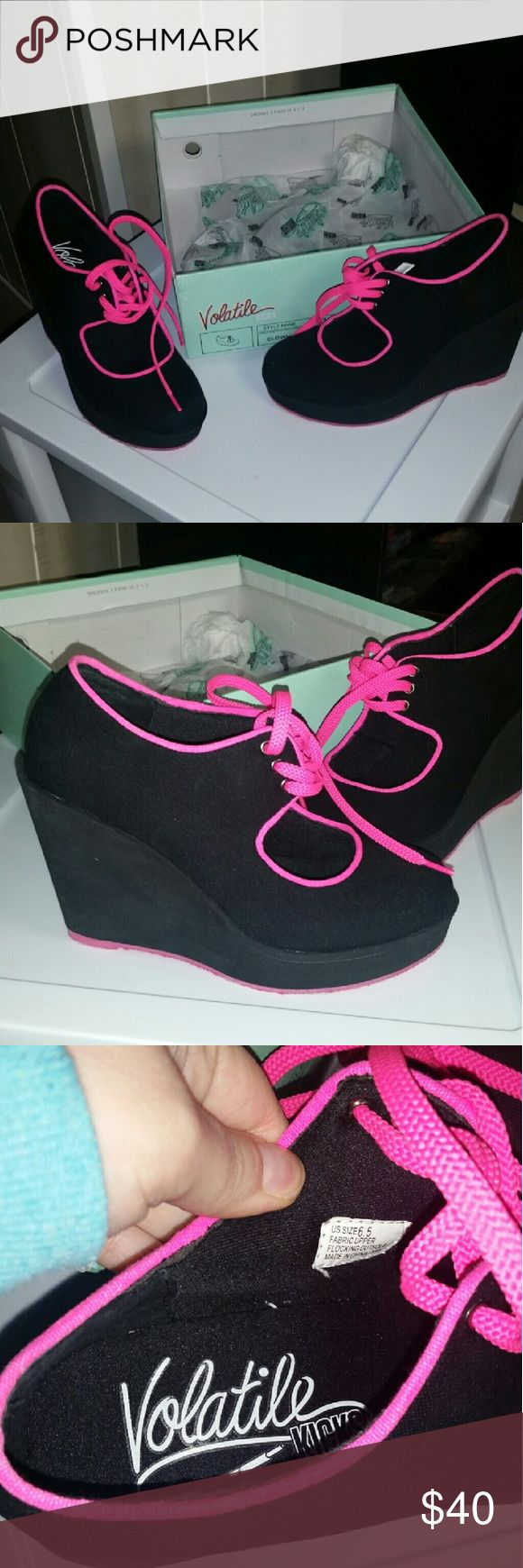NWT Volatile Black Wedges Volatile kicks black wedges with hot pink laces. I absolutely adore these shoes, but I can't pull them off  :(. BRAND NEW. I have never worn them. I have the original box but not the top it was ripped when they got shipped to me. They are so comfortable!! They don't have memory foam but it feels kind of like that inside. I'm so bummed but hopefully someone else can rock them! Volatile Shoes Wedges