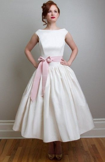This is a wonderful, and sweet for a young bride, maybe 18-45. Most flattering to your stomach and will keep you comfy and dancing. Add a bird cage veil curl as one of the other pins. Beautiful.