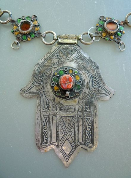 Africa | Detail from a Moroccan hamsa/khamsa necklace from the Tiznit region in South Morocco. Silver, enamel, and coral | © Kathleen McCabe -Elsey ~ Founder of Global Beads http://www.globalbeads.com