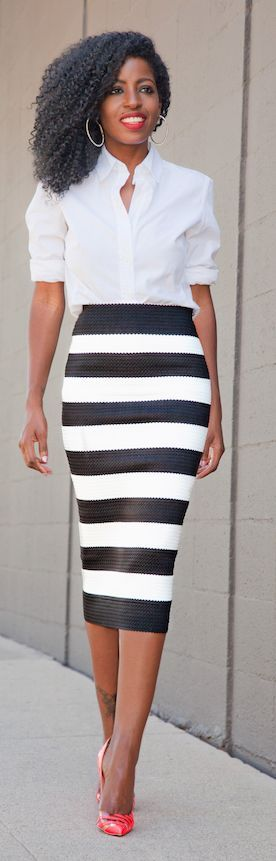 Flattering - The classic white shirt with rolled up sleeves perfectly complements this striking black & white stripe pencil skirt. Tattoo on her leg, too!