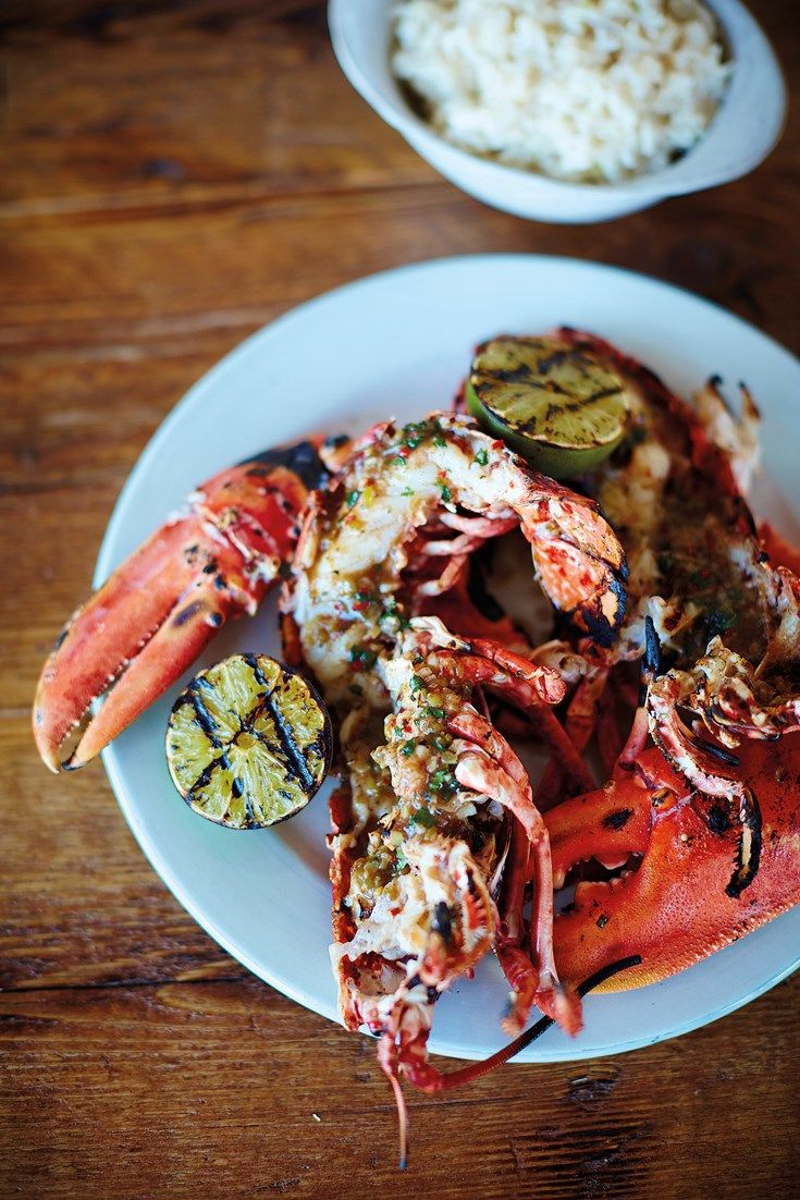 Nathan Outlaw coats fresh lobster in a spicy jerk marinade before barbecuing it at a high heat. This jerk lobster recipe is served with fragrant coconut rice, fresh coriander and charred limes, a fantastic BBQ idea from one of Britain's best seafood chefs.