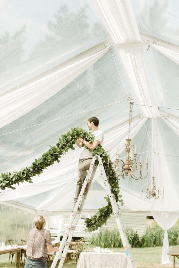 Love the idea of adding fabric around the poles/entrances to the tent to create a softer effect