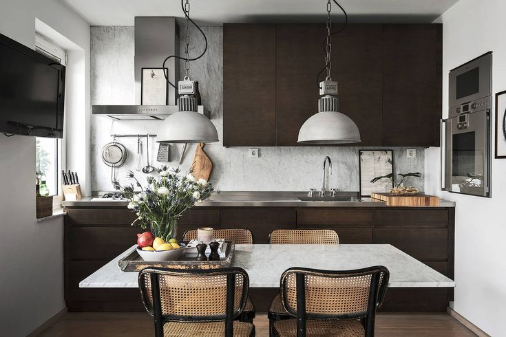 Dark industrial style kitchen with concrete wall