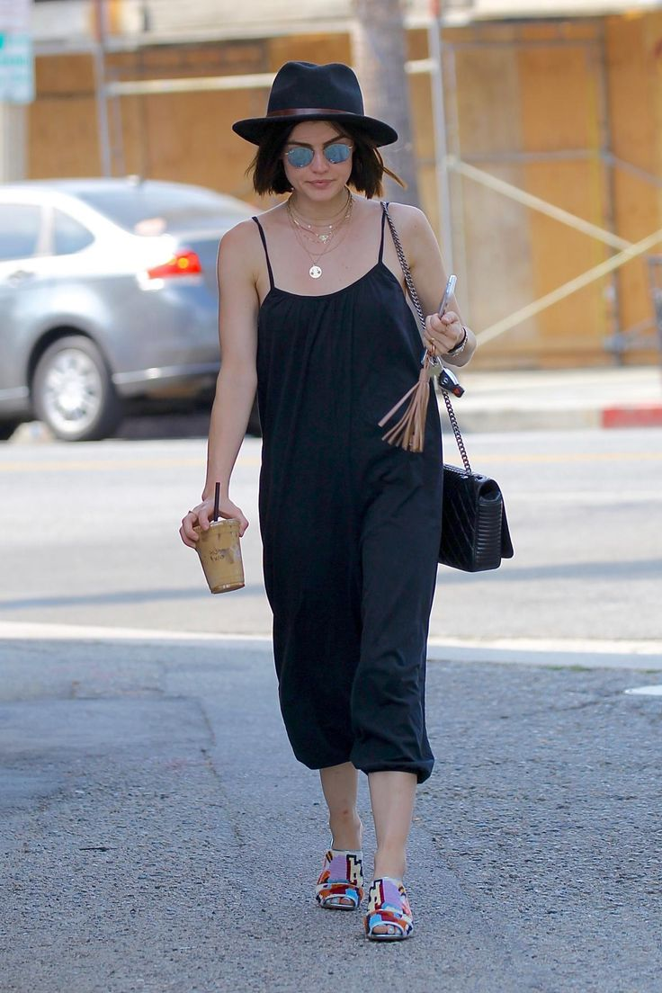 Lucy Hale wearing Ray-Ban Rb3447 Round Flash Sunglasses Sunglasses, Silence + Noise Oversized Jumpsuit, Rachel Comey Dahl Mules, Brixton Messer Fedora, Chanel Coco Boy Flap in Black, Alison Lou Large Bashful Gold with Pink Sapphires Necklace and Rolex Oyster Perpetual Datejust Watch
