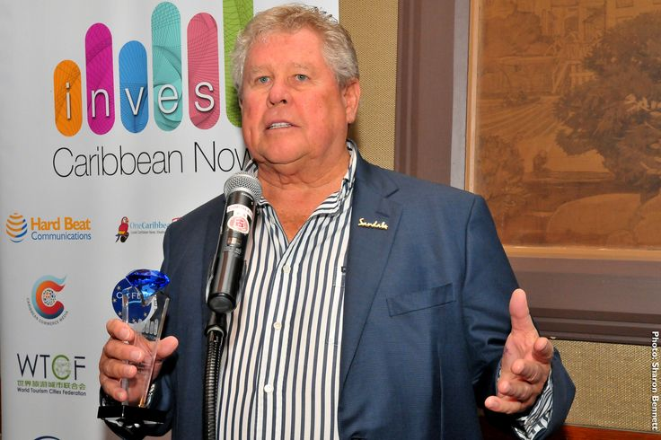Chairman of Sandals Resorts International receiving his 2014 Leadership Award at Invest Caribbean Now.