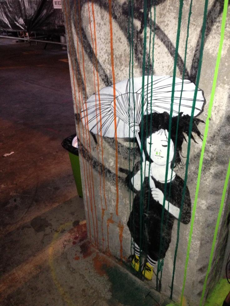 Umbrella girl in the argus building