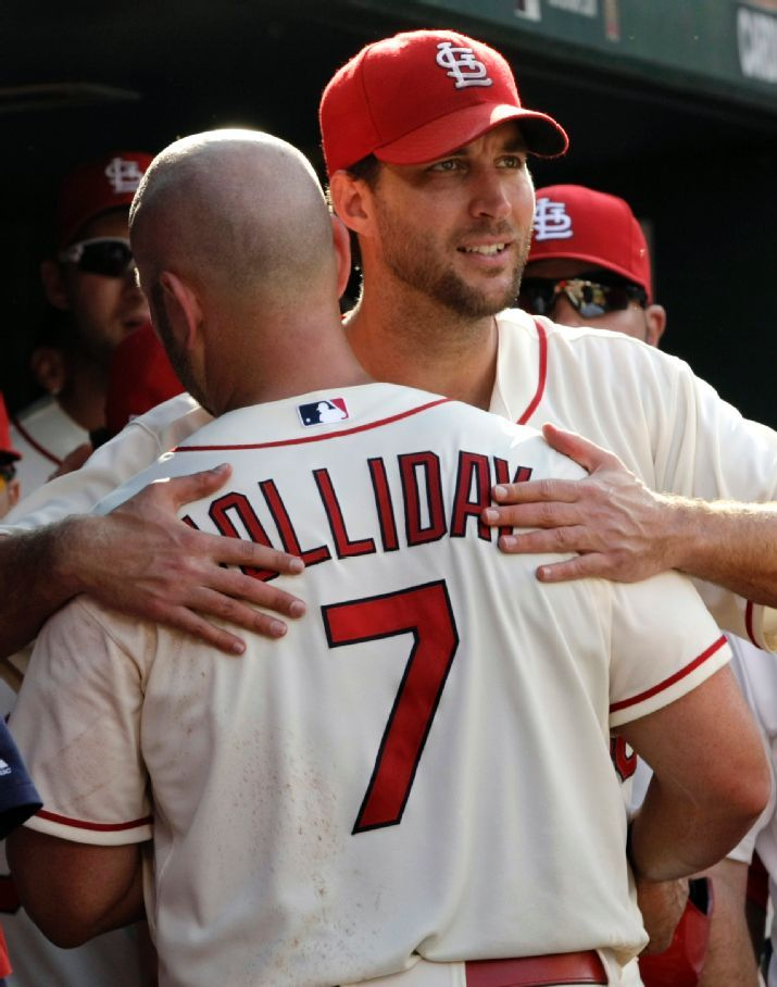 Adam Wainwright celebrates with teammate Matt Holliday after he drove in the winning run and then scored later in the eighth inning of a game against the Phillies. Cards won 4-1. 6-21-14