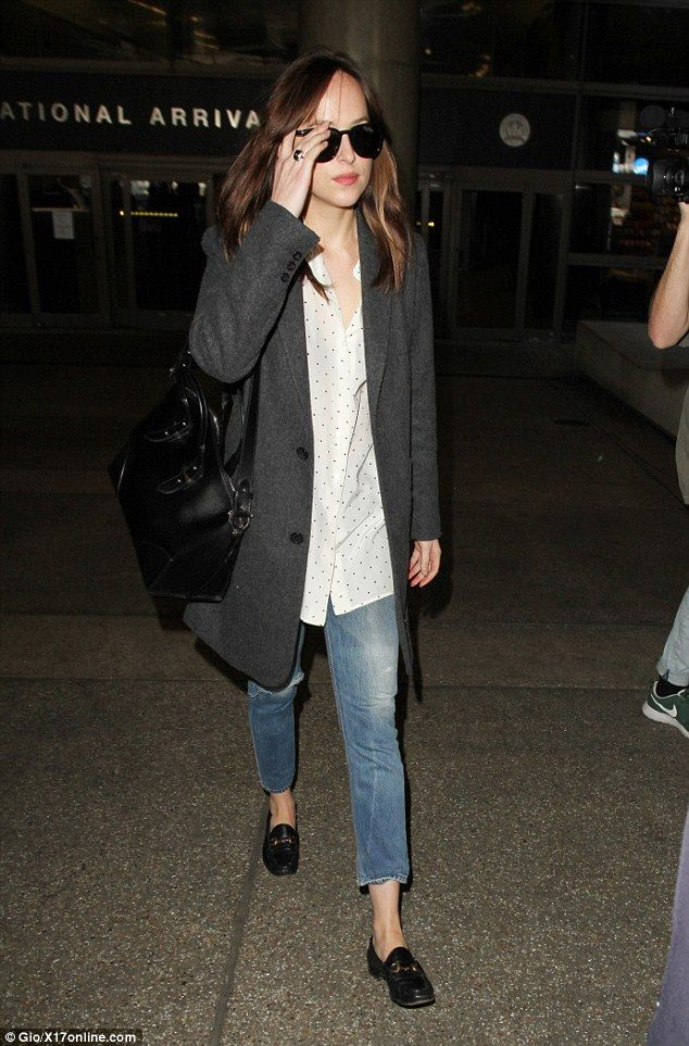 Tomboy vibes: The 27-year-old Fifty Shades Darker star was clad in a chic grey coat, worn ...