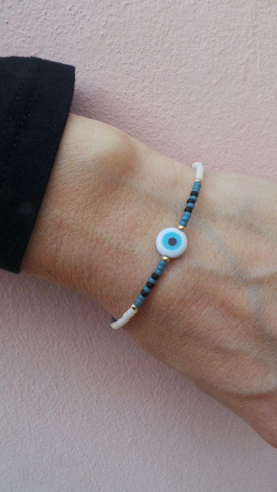 Beaded charm bracelet.Beaded evil eye by AllAboutEveCreations