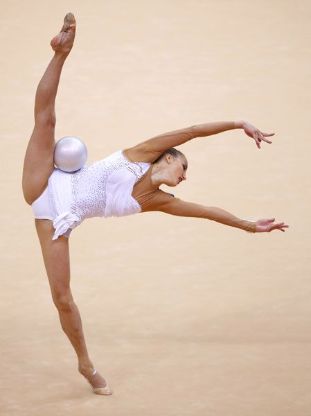 Ukraine's Ganna Rizatdinova competes using the ball in her individual all-around gymnastics qualification match (London 2012).