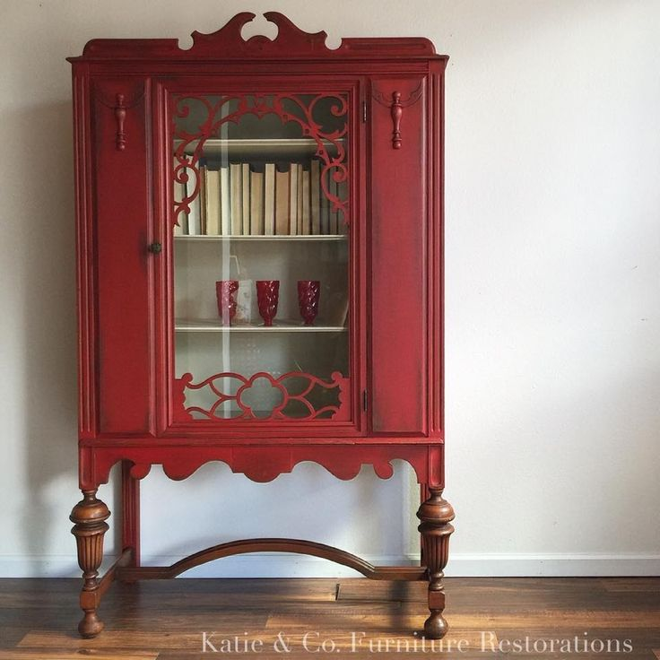 Antique china cabinet painted in Holiday Red with a medium distress and a coat of dark wax to bring out the detail. This was the first big red piece I did. Now I can't stop using this beautiful color!!!