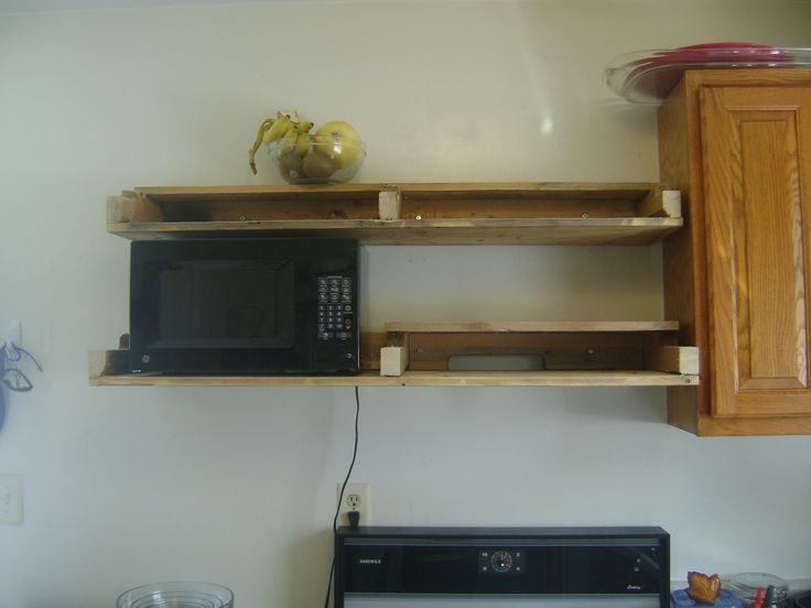 My husband built this floating shelf out of pallets...did it in less than a day. Thought I would post it because it is such a functional way to add counter space by getting the microwave off of the counter (without spending mucho bucks on a new over the counter microwave) and adding cabinet space in a small kitchen without adding more cabinets. I think this adds more character and looks better than more boring cabinets. I put our plates and mugs on it this.  Looks way cool :)