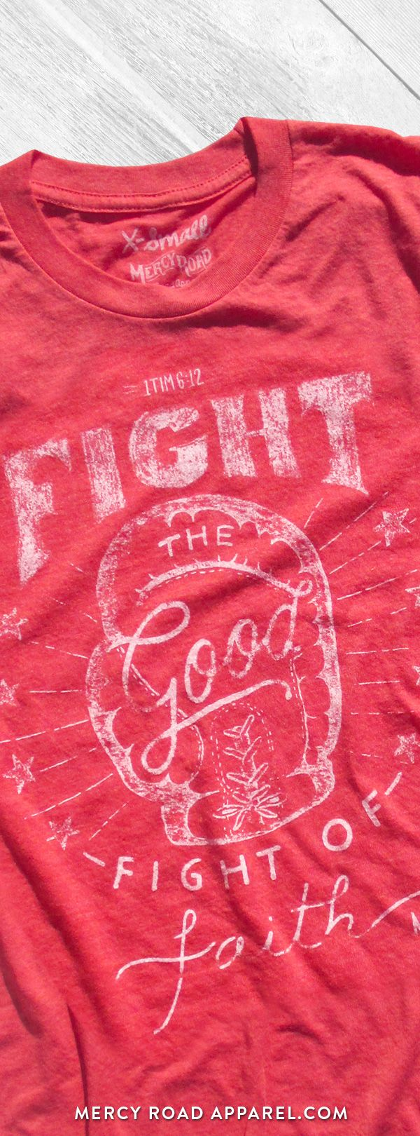 "Christian T-Shirt with vintage boxing theme and scripture 1 Timothy 6:12 ""Fight the good fight of faith."" This faith shirt is handcrafted and screenprinted on a gloriously comfy red triblend tee. Quality Christian clothing for women and men. FREE SHIPPING USA. Shop >> MercyRoadApparel.com"