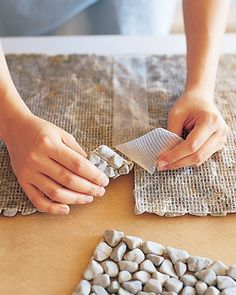 make your own : stone spa mat #DIY I would actually like to make my downstairs bathroom floor out of smooth stones! Wouldn't that be pretty?