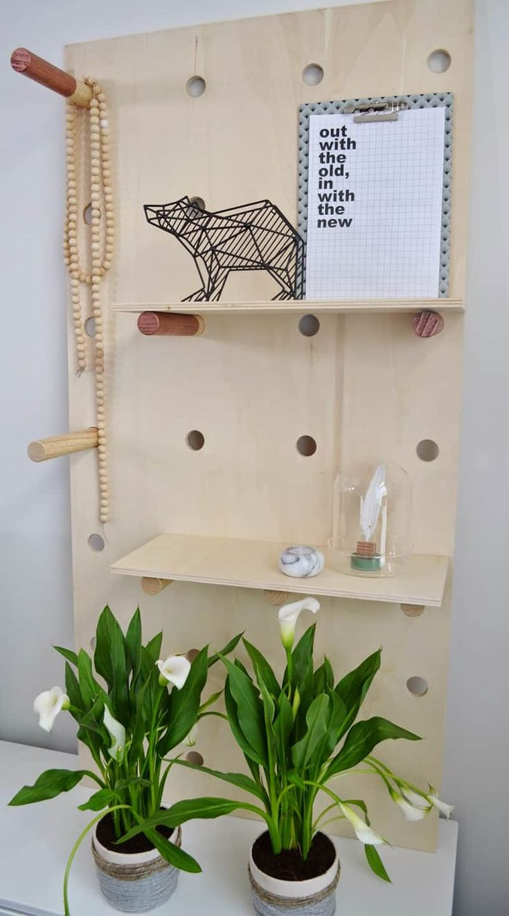Need more garage organization ideas? Create a pretty organization system with these pegboard shelves! Peg board wall is always a good idea!