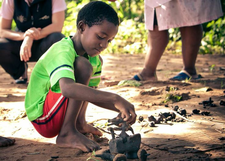 Village life lessons - making cars out of earth materials
