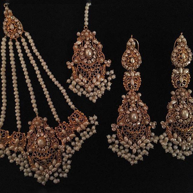 1c4cc07cedf Earrings tikka and jhoomar set in fresh water pearls.