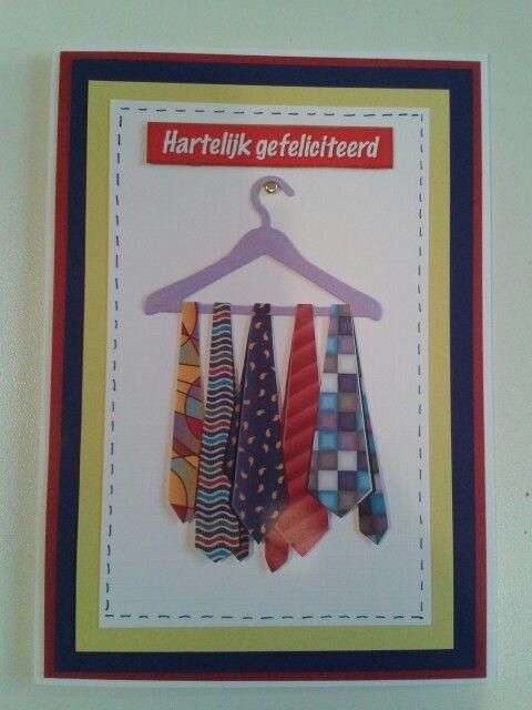 Mannenkaart met stropdassen aan kledinghanger.