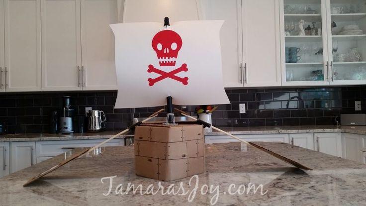 DIY Boys Pirate Costume. It's a pirate ship made from Cardboard! TamarasJoy.com