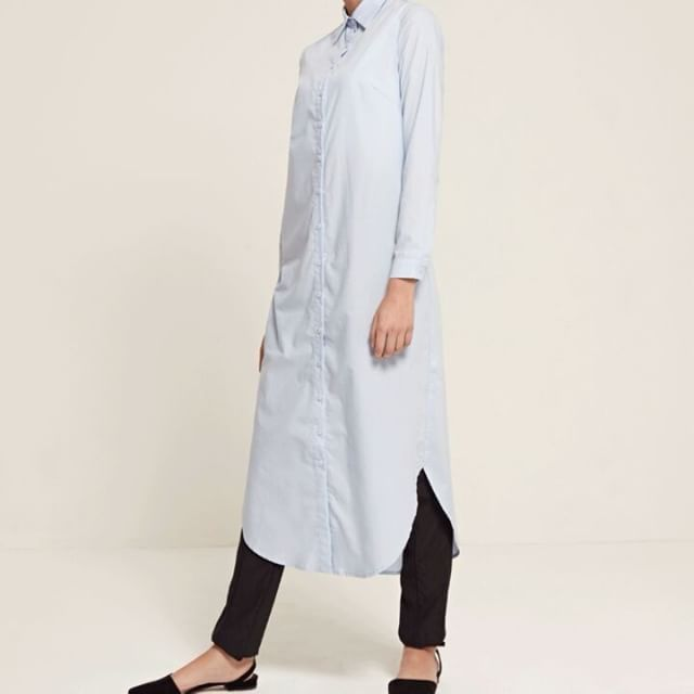 INAYAH | Tailored basics are essential to every wardrobe. Our Midi Shirt is cut from breathable cotton in a comfortable and loose silhouette.  Blue Cotton Midi Shirt  Black Straight Leg Trousers  www.inayah.co