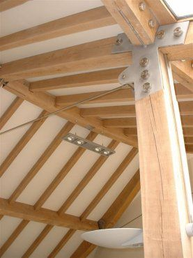 Contemporary oak frame with steel fixings by Roderick James Architects.