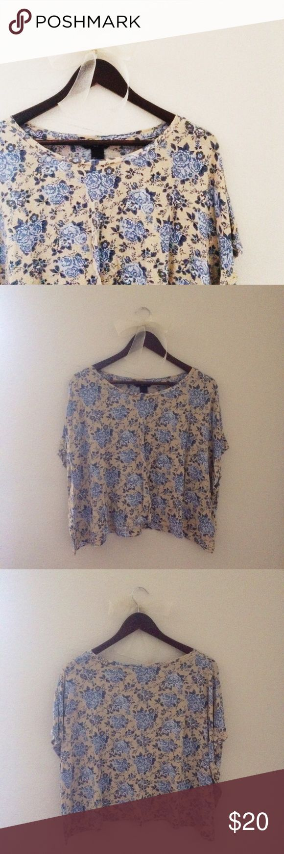 Floral Loose Top This loose top looks great with dark blue jeans! Blue & light yellow/cream. 100% Viscose.  ✅Reasonable offers welcome! ✅BUNDLE DISCOUNTS! 🚫No trades/paypal/other apps. 🚫No lowball offers. H&M Tops