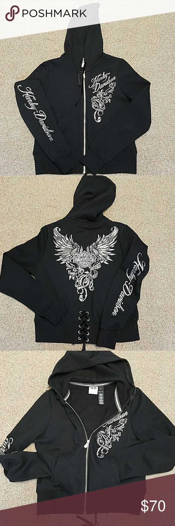 Harley Davidson Sweatshirt Harley Davidson Ladies sweatshirt. Worn once. Zip up hoodie with lacing in back. Bling on right sleeve, back and front.  Really cute.  See pic for length. Harley-Davidson Tops Sweatshirts & Hoodies