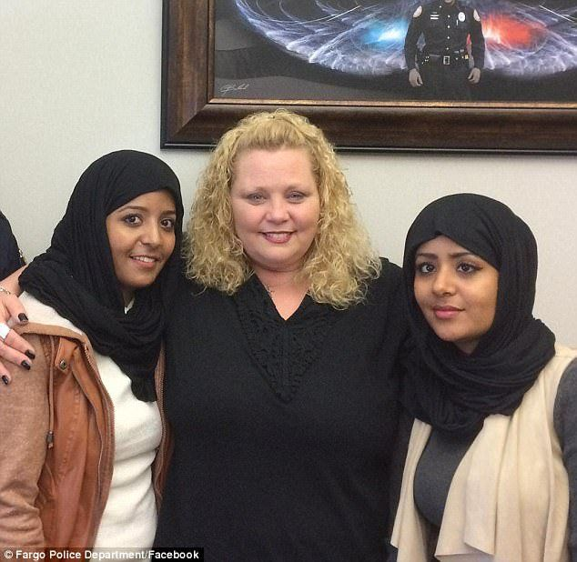 """Three Somali women were confronted by a white woman who screamed profanity-laced threats at them in a Walmart parking lot in Fargo, North Dakota, and the footage has gone viral. That cost the woman her job as a secretary and a heap of embarrassment,but the video tells only half the story. The video shows Amber Elizabeth Hensley leaning into a passenger window and telling Sarah Hassan who was filming, """"We're going to kill all of ya, we're going to kill every one of you f***ing Muslims."""""""