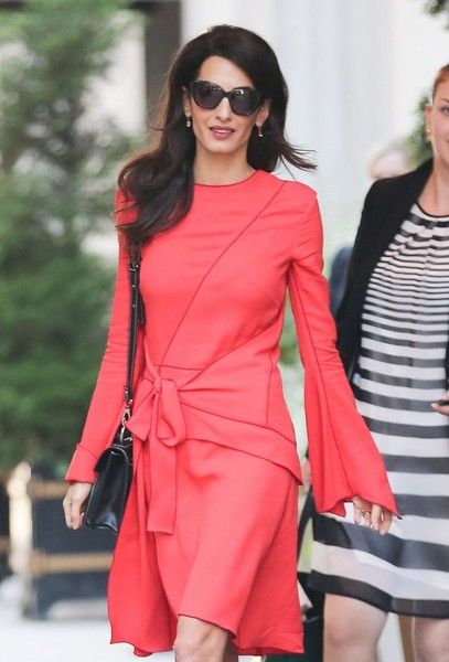 Amal Clooney Photos Photos - Layer Amal Clooney steps out wearing a bright pink dress in New York City, New York on September 22, 2016. Amal and her husband, actor George Clooney, will be celebrating their second wedding anniversary on September 27. - Amal Clooney Steps Out In New York City