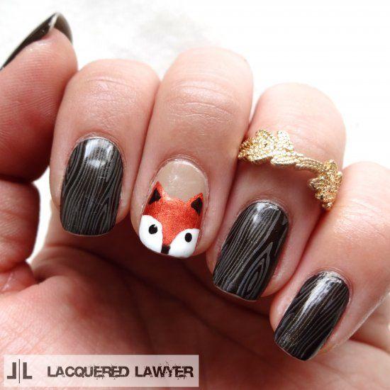 Fox nail art with wood grain nail stamping.