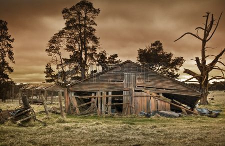 old farm building all forgotten and falling down photo