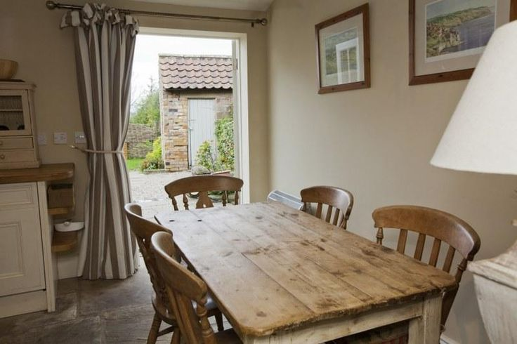 The kitchen at Egton Cottage looks out onto the lovely cottage garden, with stunning views across the North York Moors beyond.