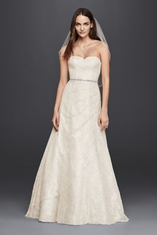 This A-line wedding dress embodies effortless classic elegance thanks to its simple lines, sweetheart neckline, and allover lace. A subtle gathering at the hip creates a bit of intrigue as the skirt cascades in a petal-like layer.  DB Studio, Exclusively at David's Bridal  Polyester  Chapel train  Back zipper; Fully lined  Dry clean  Imported  Also available in Plus Sizes, Extra Length, and Plus Size Extra Length.