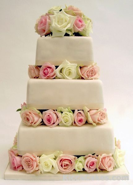 Modern square wedding cake blocked with roses
