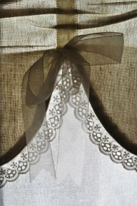 idea for a simple burlap valance with lace, use velvet bow. burlap curtains below that have been  embellished with a piecee a lace across the curtains at about 18 inches /informal dining room