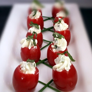 Cream cheese stuffed cherry tomatoes.  Good appetizer idea